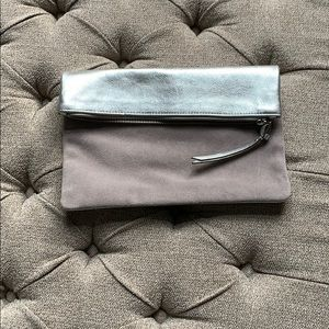 Practically new, leather metallic and suede clutch